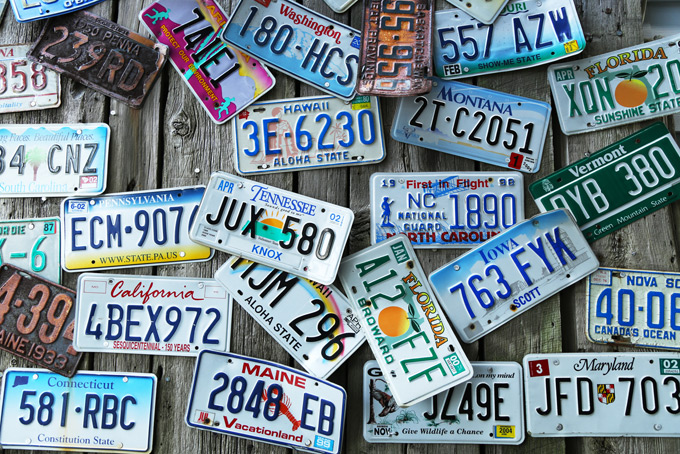 American license plates, lying on wooden boards.