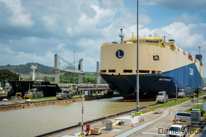 Admire the Panama Canal.