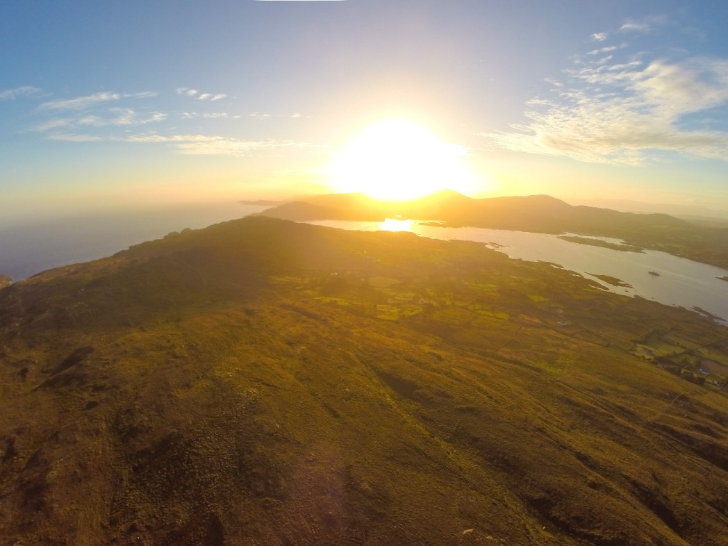 Bere Island at dusk, aerial view over the yellow fields