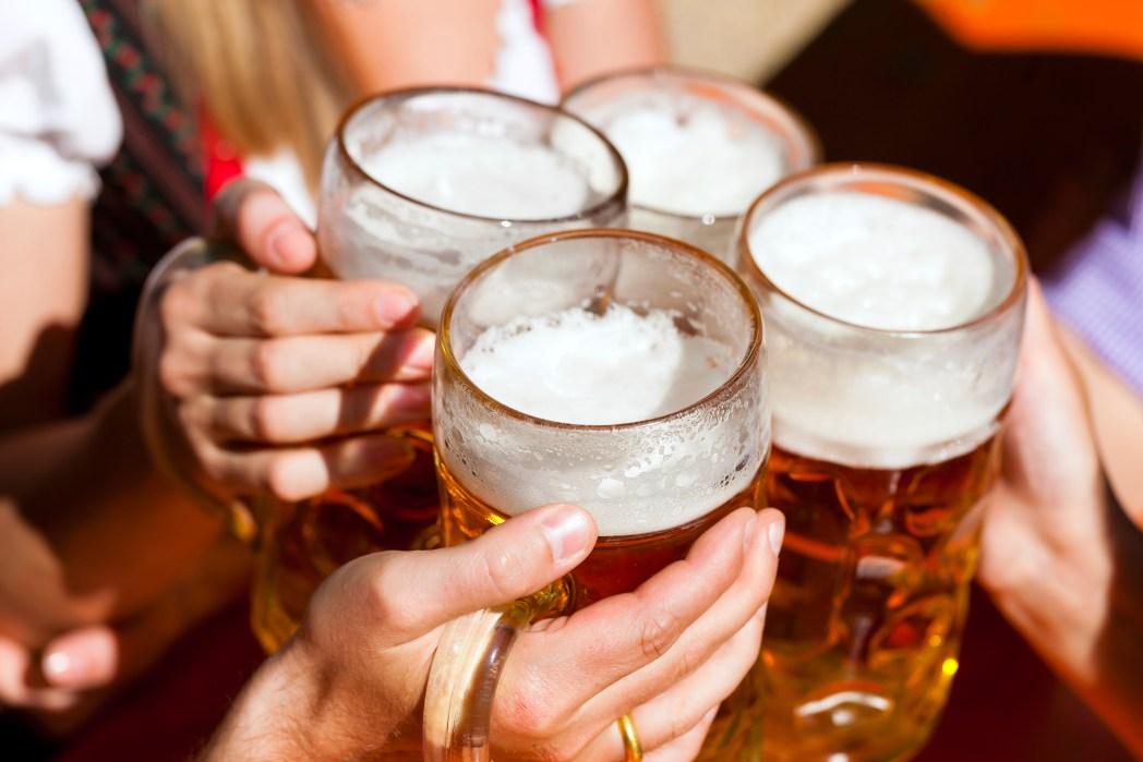 Friends drinking beer at Oktoberbest, Munich