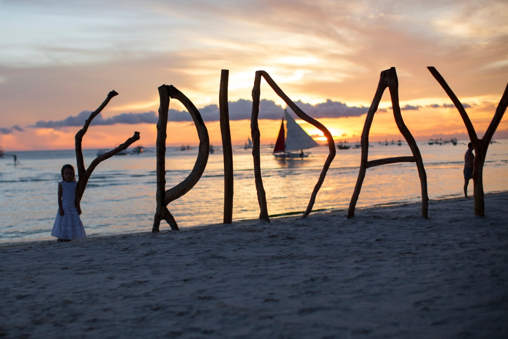 Friday spelled out in letters on the beach