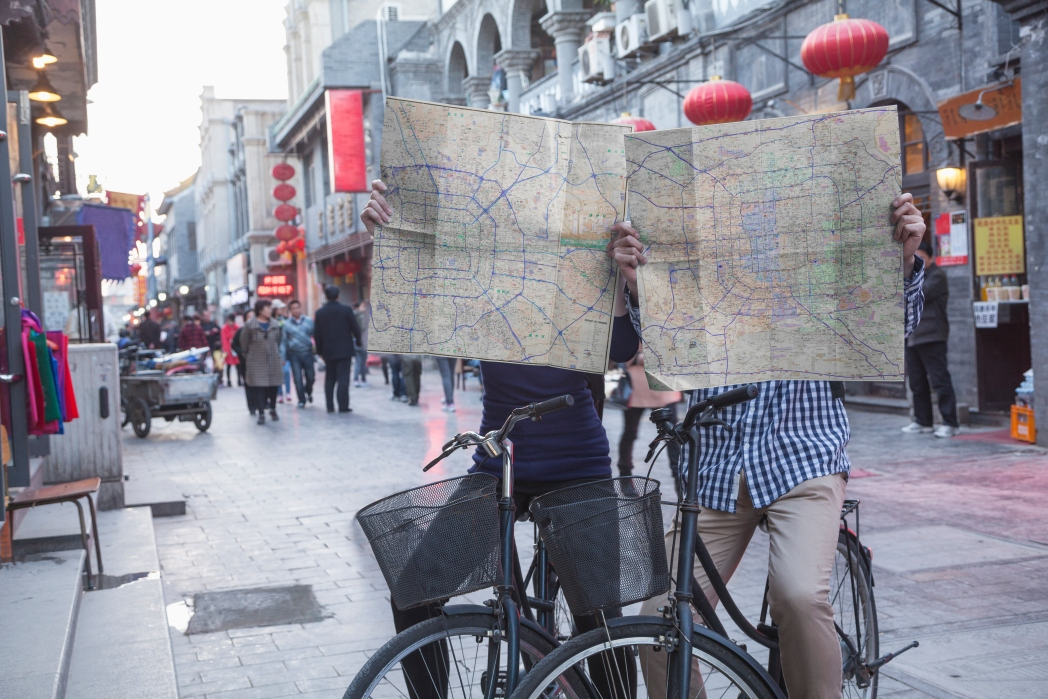Couple navigating Beijing by bicycle
