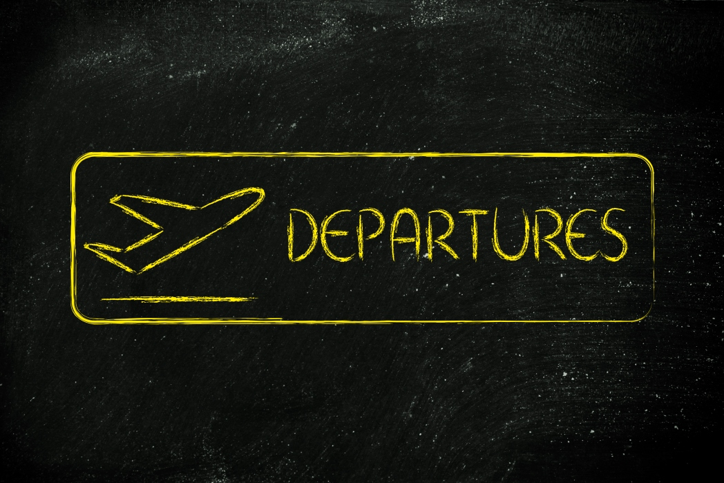 Departures written on a chalk board