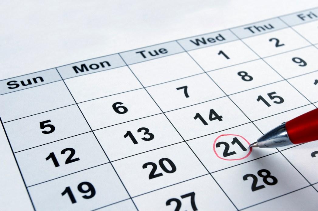 A pen circling the 21st on a calendar