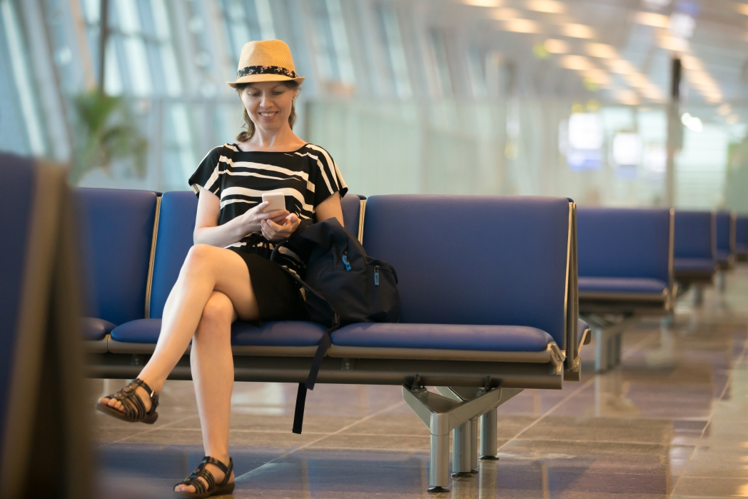 Woman in train station looking at her phone