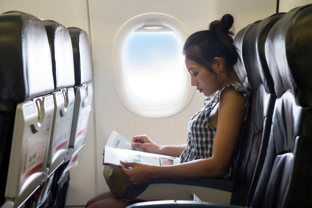Reading magazines on flight