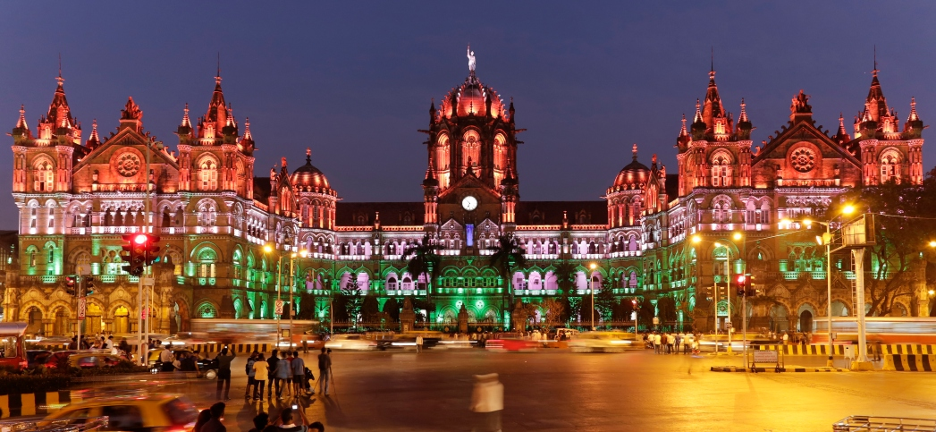 Where to stay in Mumbai, building lit up with coloured lights at night