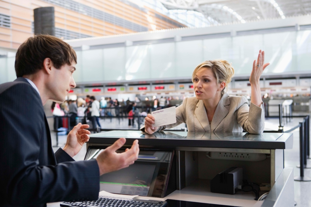 Woman shouting at check-in desk