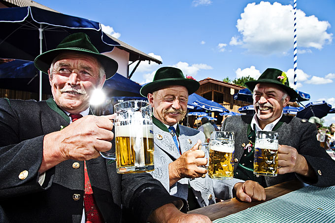 men in traditional costume drinking beer, Bavaria