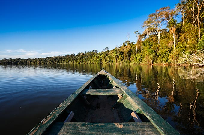 Tour the waterways of the incredible Amazon rainforest by boat.