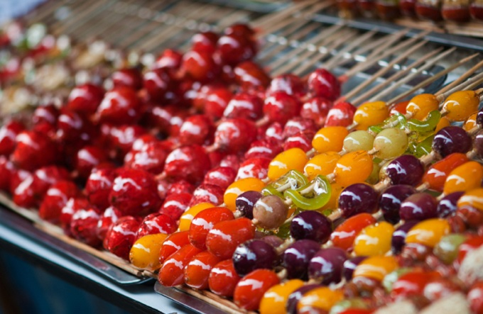 Candied fruit on sticks in China.