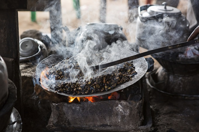 Traditional coffee brewing in Addis Ababa. Click the image to find a hotel.