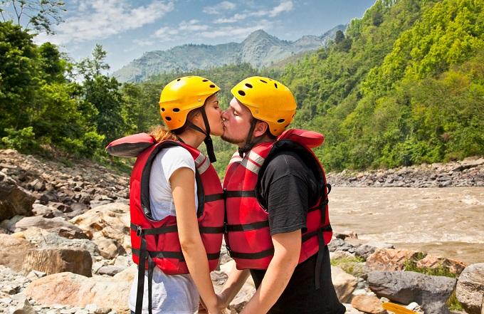 rafting couple kissing