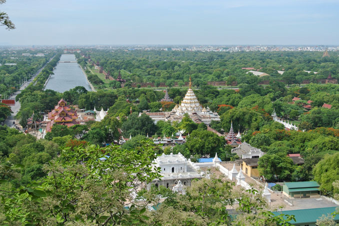View across Mandalay from the top of the hill, pagoda, moat, palace, trees ©Catherine McGloin