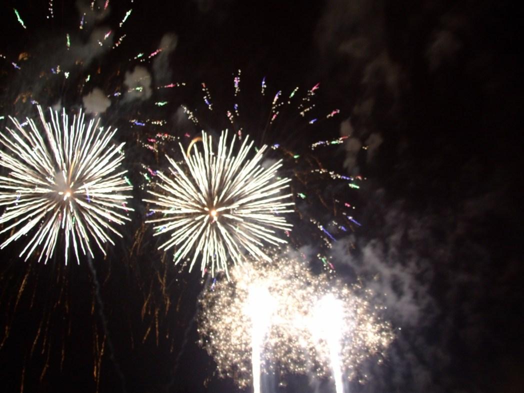 White fireworks exploding in the black night sky