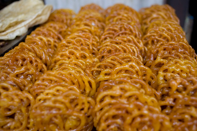 Jalebi, stacked in a basket, India.