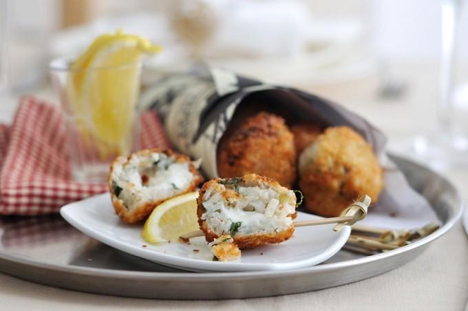 Arancini rice balls with lemon, Italy.