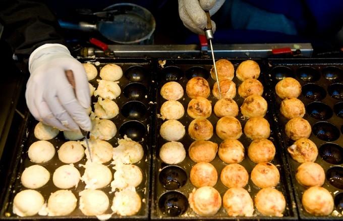 Takoyaki octopus balls being made, Japan.