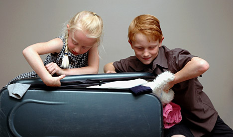 two children and a suitcase