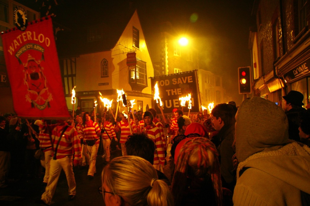 Fireworks procession in Lewes, people marching in the street with torches