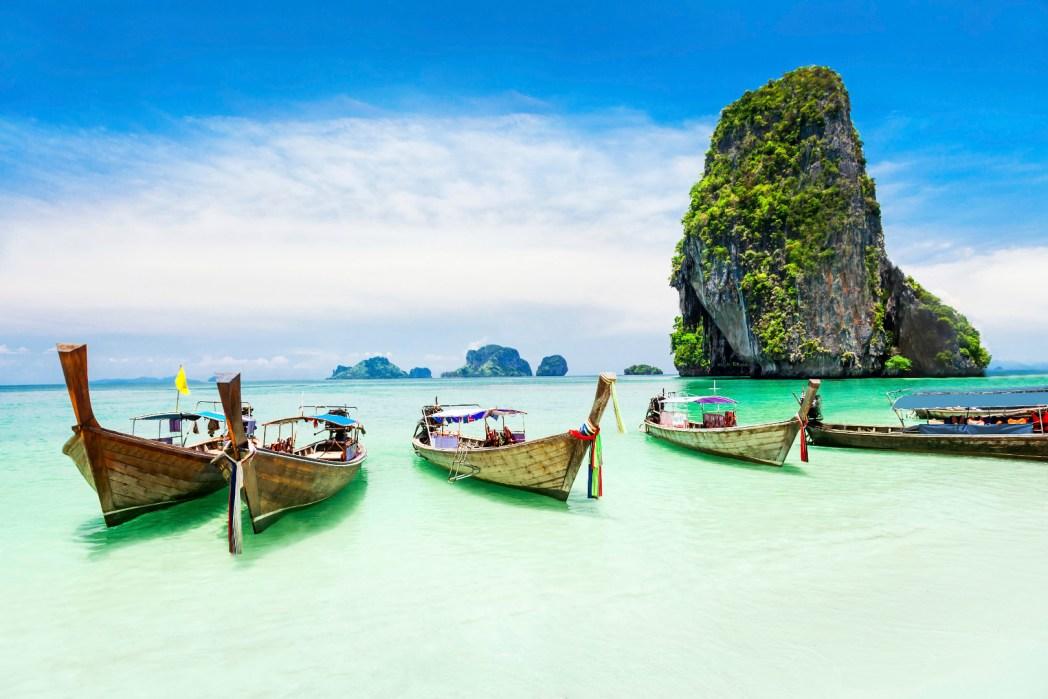 Longboats on a beach in Phuket.