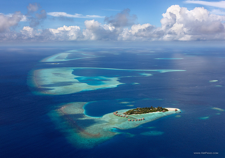 Lone Island, Maldives, aerial view of the small island surrounded by blue ocean