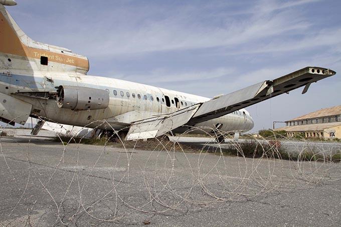 Nicosia International Airport abandoned plane by Yiannis Kourtoglou shutterstock.com