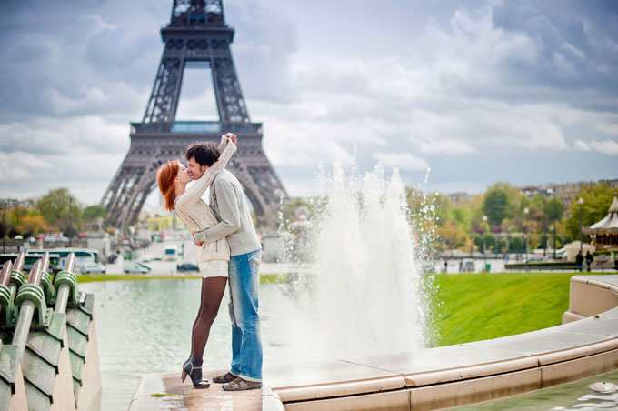 couple kissing with Eiffel Tower in background