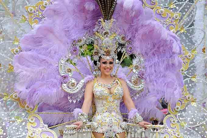 woman in costume at Tenerife Carnival © Algefoto / Shutterstock.com'