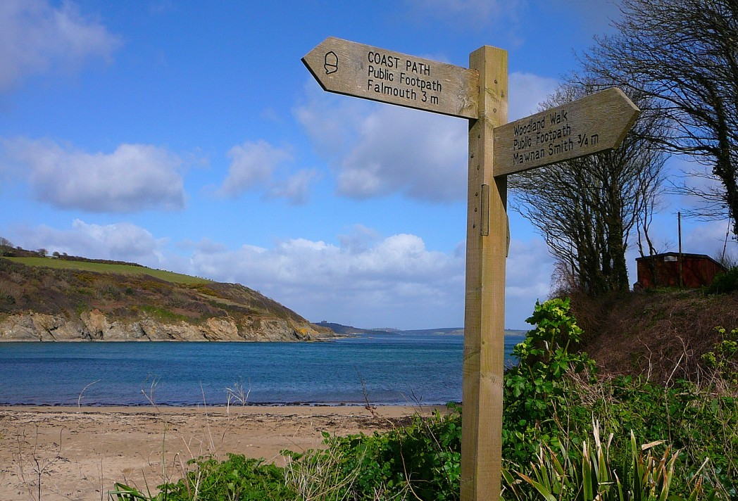 Signpost on a beach along the South West Coast Path, Cornwall