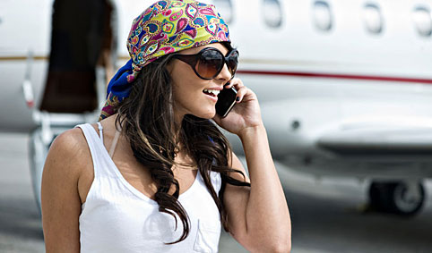 woman on phone by jet