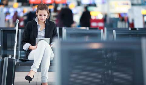 woman working on tablet in airport
